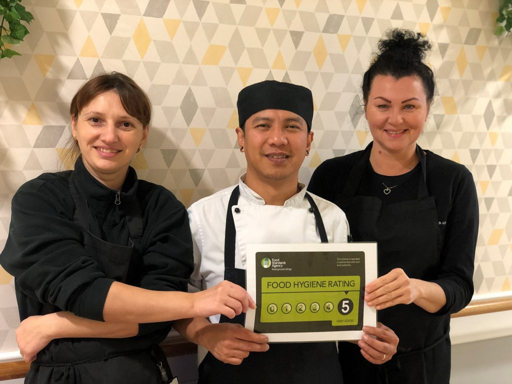 Kitchen staff with 5 stars